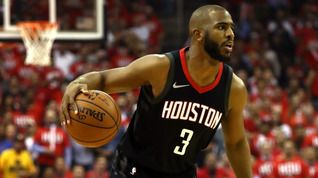 Chris Paul #3 of the Houston Rockets handles the ball in the first half against the Golden State Warriors in Game One of the Western Conference Finals of the 2018 NBA Playoffs at Toyota Center on May 14, 2018 in Houston, Texas.