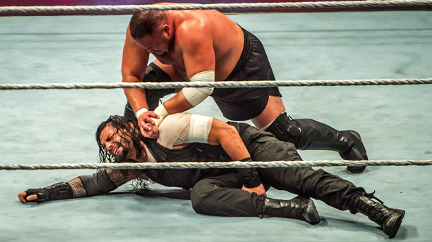 Roman and Samoa Joe (R) battle during the WWE show at Zenith Arena on may 09, 2017 in Lille, France.