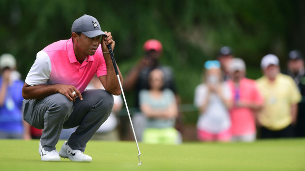 Tiger Woods reads the third green during the third round of the 2018 Wells Fargo Championship at Quail Hollow Club on May 5, 2018 in Charlotte, North Carolina.