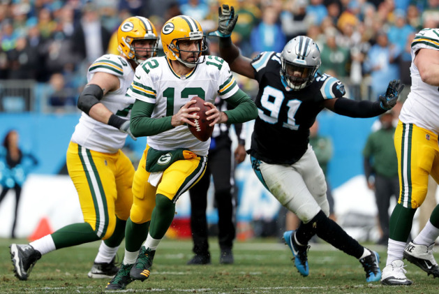 Aaron Rodgers #12 of the Green Bay Packers runs the ball against the Carolina Panthers in the second quarter during their game at Bank of America Stadium on December 17, 2017 in Charlotte, North Carolina.