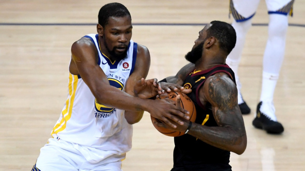 LeBron James #23 of the Cleveland Cavaliers defended by Kevin Durant #35 of the Golden State Warriors in Game 1 of the 2018 NBA Finals at ORACLE Arena on May 31, 2018 in Oakland, California.