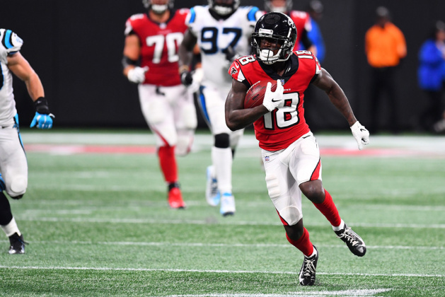 Calvin Ridley #18 of the Atlanta Falcons runs after a catch during the first half against the Carolina Panthers at Mercedes-Benz Stadium on September 16, 2018 in Atlanta, Georgia.