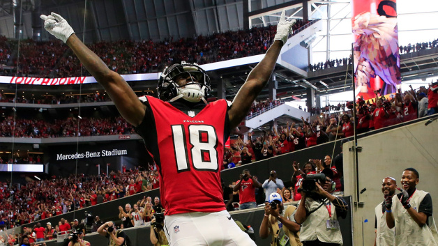 Calvin Ridley #18 of the Atlanta Falcons celebrates a touchdown catch during the first half against the New Orleans Saints at Mercedes-Benz Stadium on September 23, 2018 in Atlanta, Georgia.