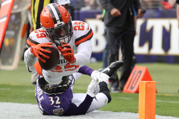 Running back Duke Johnson #29 of the Cleveland Browns runs towards the end zone as free safety Eric Weddle #32 of the Baltimore Ravens tackles him in the four quarter at M&T Bank Stadium on September 17, 2017 in Baltimore, Maryland.