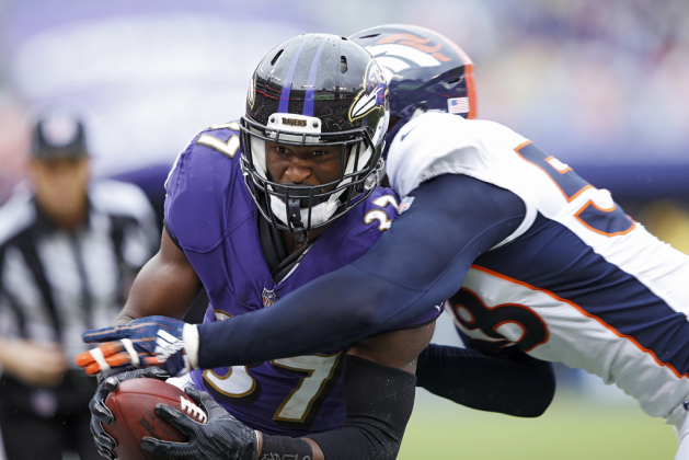 Javorius Allen #37 of the Baltimore Ravens dives into the end zone for a 12-yard touchdown after catching a pass in the second quarter of the game against the Denver Broncos at M&T Bank Stadium on September 23, 2018 in Baltimore, Maryland.