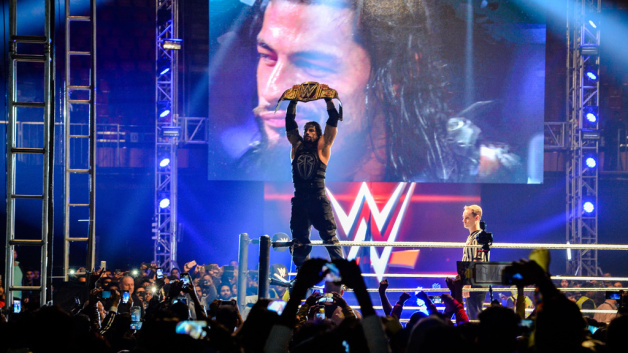 Wrestler Roman Reigns holds up the Championship Belt during the World Wrestling Entertainment (WWE) Live India Tour in New Delhi. Enthusiastic fans flocked to the event as WWE returned to the country after an interval of 13 years.
