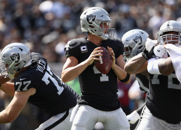 Derek Carr #4 of the Oakland Raiders looks to pass the ball against the Cleveland Browns at Oakland-Alameda County Coliseum on September 30, 2018 in Oakland, California.