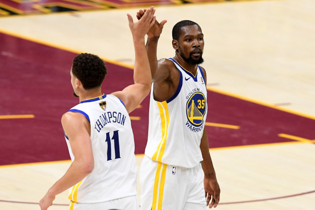 Klay Thompson #11 and Kevin Durant #35 of the Golden State Warriors react after a play in the second half against the Cleveland Cavaliers during Game Four of the 2018 NBA Finals at Quicken Loans Arena on June 8, 2018 in Cleveland, Ohio. NOTE