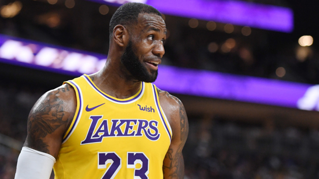 LeBron James #23 of the Los Angeles Lakers walks on the court during a stop in play in a preseason game against the Golden State Warriors at T-Mobile Arena on October 10, 2018 in Las Vegas, Nevada. The Lakers defeated the Warriors 123-113.