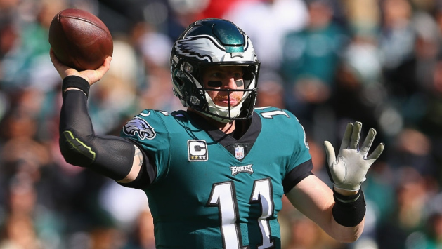 Quarterback Carson Wentz #11 of the Philadelphia Eagles looks ot pass against the Carolina Panthers during the second quarter at Lincoln Financial Field on October 21, 2018 in Philadelphia, Pennsylvania. The Carolina Panthers won 21-17.