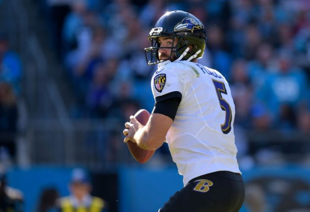 Joe Flacco #5 of the Baltimore Ravens looks to pass against the Carolina Panthers during their game at Bank of America Stadium on October 28, 2018 in Charlotte, North Carolina. The Panthers won 36-21.