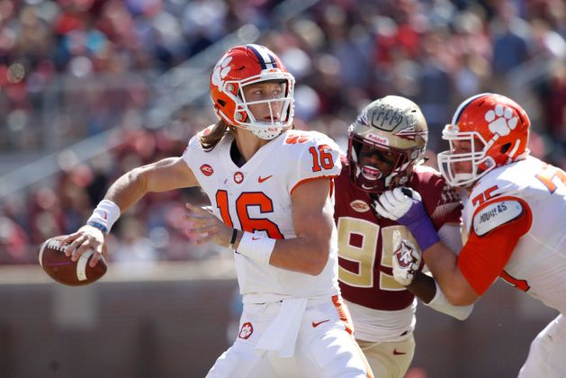 Trevor Lawrence #16 of the Clemson Tigers throws a pass in the second quarter of the game against the Florida State Seminoles at Doak Campbell Stadium on October 27, 2018 in Tallahassee, Florida.