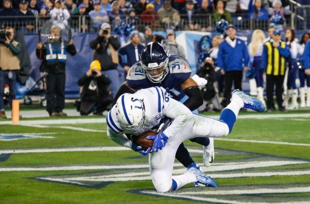 Eric Ebron #85 of the Indianapolis Colts catches a pass to score a touchdown while defended by Kevin Byard #31 of the Tennessee Titans during the second quarter at Nissan Stadium on December 30, 2018 in Nashville, Tennessee.