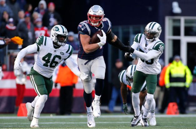Rob Gronkowski #87 of the New England Patriots carries the ball during the third quarter of game against the New York Jets at Gillette Stadium on December 30, 2018 in Foxborough, Massachusetts.