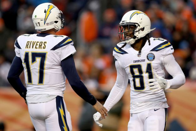 Quarterback Philip Rivers #17 and wide receiver Mike Williams #81 of the Los Angeles Chargers celebrate a touchdown against the Denver Broncos at Broncos Stadium at Mile High on December 30, 2018 in Denver, Colorado.