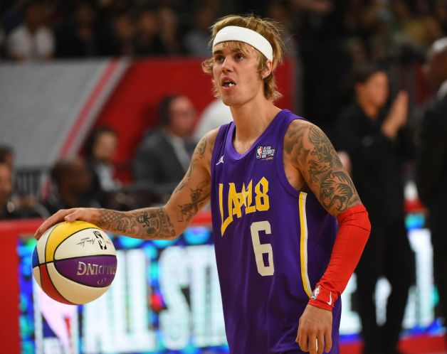Canadian singer and songwriter Justin Bieber plays during the 2018 NBA All-Star Game Celebrity Game at Los Angeles Convention Center on February 16, 2018 in Los Angeles, California.