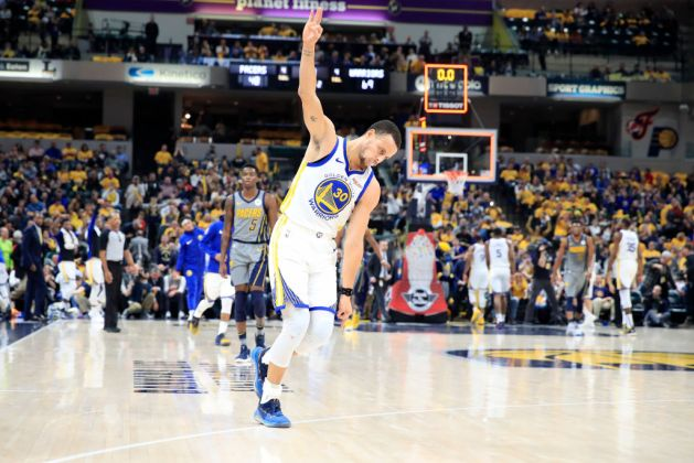 Stephen Curry #30 of the Golden State Warriors celebrates after making a basket to end the first half against the Indiana Pacers at Bankers Life Fieldhouse on January 28, 2019 in Indianapolis, Indiana.