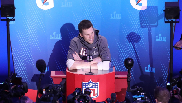 Quarterback Tom Brady #12 of the New England Patriots talks to the media during Super Bowl LIII Opening Night at State Farm Arena on January 28, 2019 in Atlanta, Georgia.