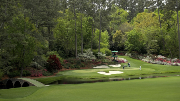 A general view is seen as Xander Schauffele of the United States putts on the the 12th green during the final round of the 2018 Masters Tournament at Augusta National Golf Club on April 8, 2018 in Augusta, Georgia.