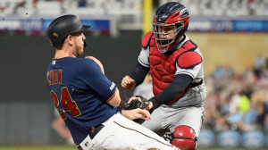 Roberto Perez #55 of the Cleveland Indians defends home plate against C.J. Cron #24 of the Minnesota Twins during the fourth inning of the game on August 10, 2019 at Target Field in Minneapolis, Minnesota.